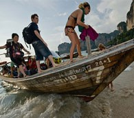 Backpacker arriving at Tailay beach, Thailand