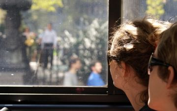 bus passengers looking out window
